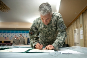 General Casey signing papers
