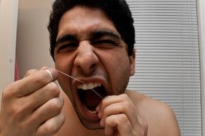 man flossing