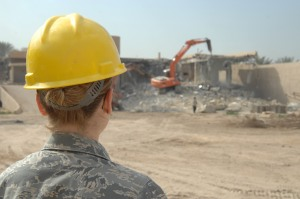 Payment Officer looking at demolition
