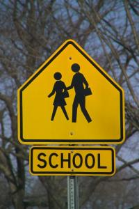 school children crossing sign